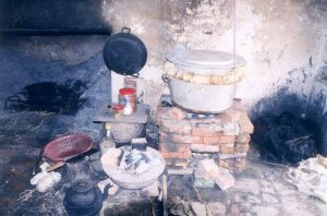 simple kitchen with brick cooking burner