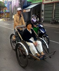 cyclo driver and woman passenger