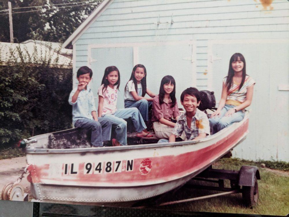 nguyen-kids-in-a-boat